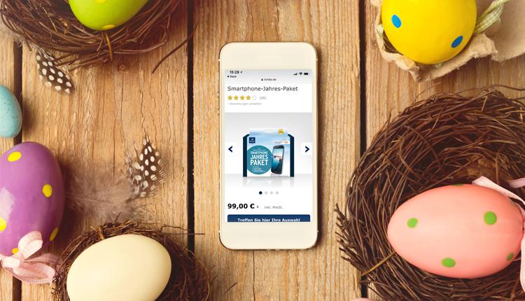 Smartphone mit Tchibo-Angebot auf Oster-Hintergrund